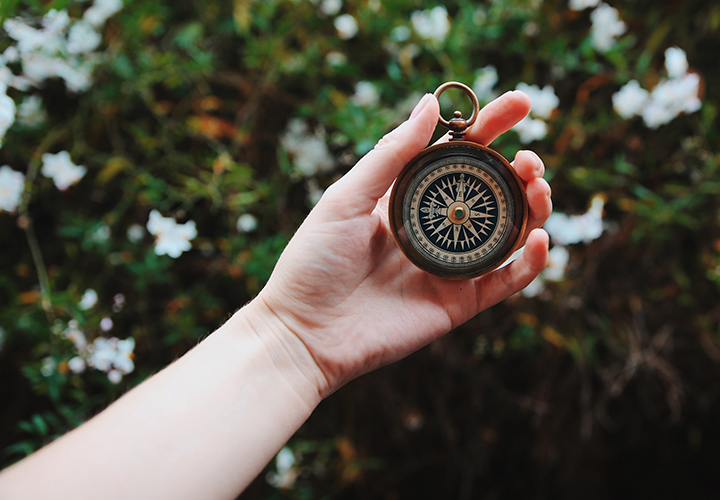 Compass. Photo by Heidi Sandstrom, Unsplash.