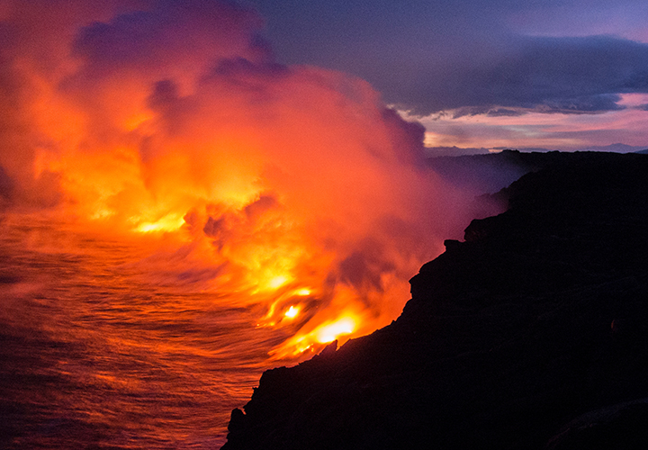 Lava meeting the ocean at Kīlauea, Hilo, United States. Photo by Mandy Beerley, Unsplash.