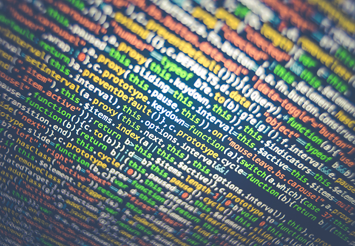 Wall of code. Photo by Markus Spiske, Unsplash.